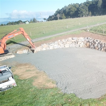 House site excavation volcanic paddock stone retaining wall