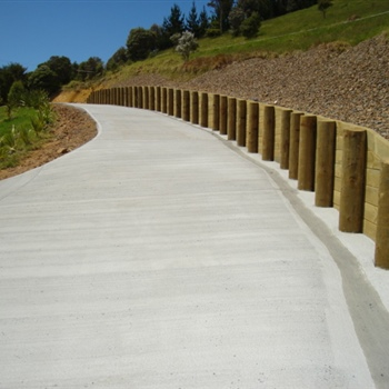 Concrete driveway timber retaining wall
