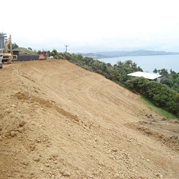 Earthwall with soilder piling at bottom to gain more lawn at Matapouri Heights Tutukaka Coast